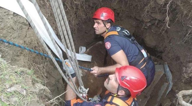 Kuyuya düşen inek, itfaiye ekipleri tarafından kurtarıldı