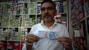 Üzerinde 10 yazan 100 liralık banknot görenleri şaşırttı