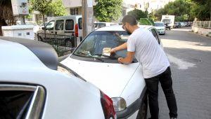 Karşıyaka'da Araçlara ilan bırakanlara ceza yağacak