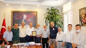 Muhtarlardan Başkan Eriş'e teşekkür plaketi